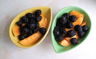 Kesar mango and blackberries